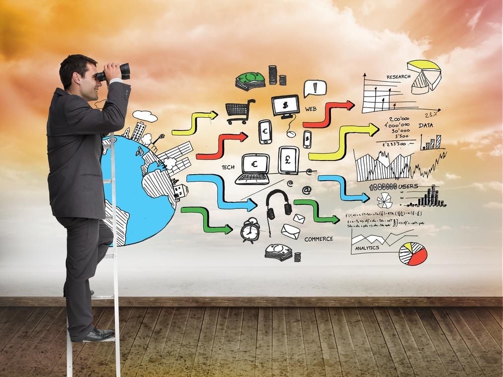 Composite image of businessman standing on ladder holding binoculars.jpeg